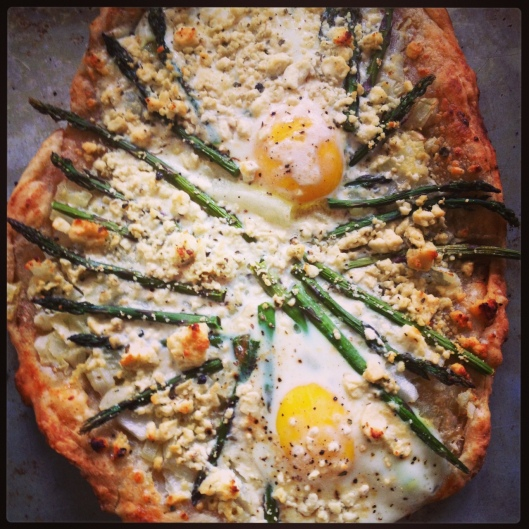 I haven't been cooking much lately, but I was inspired to throw this together after a stressful day. A puff pastry pizza with asparagus, feta, and eggs. Just things I had laying around. It turned out pretty good! Always a Win for me when I make something that doesn't completely bomb.